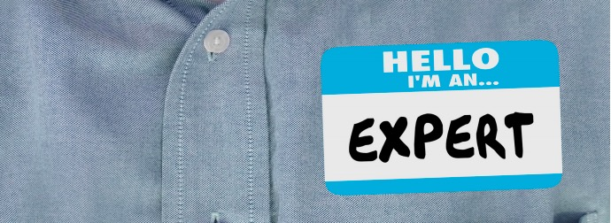 """Sachverständige im Handwerk: Männerhemd mit Aufkleber """"Hello I'm an Expert"""""""